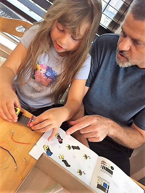 dad and daughter playing with stem toys