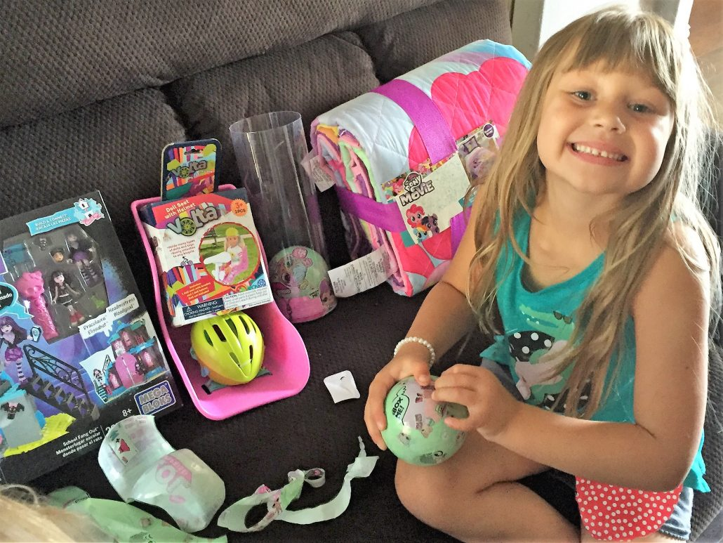 girl opening birthday presents