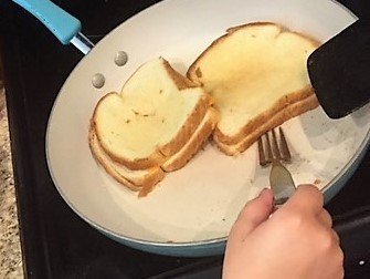 cooking grilled cheese