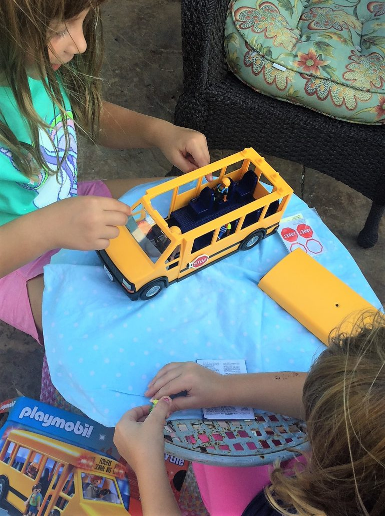 kids playing with school bus