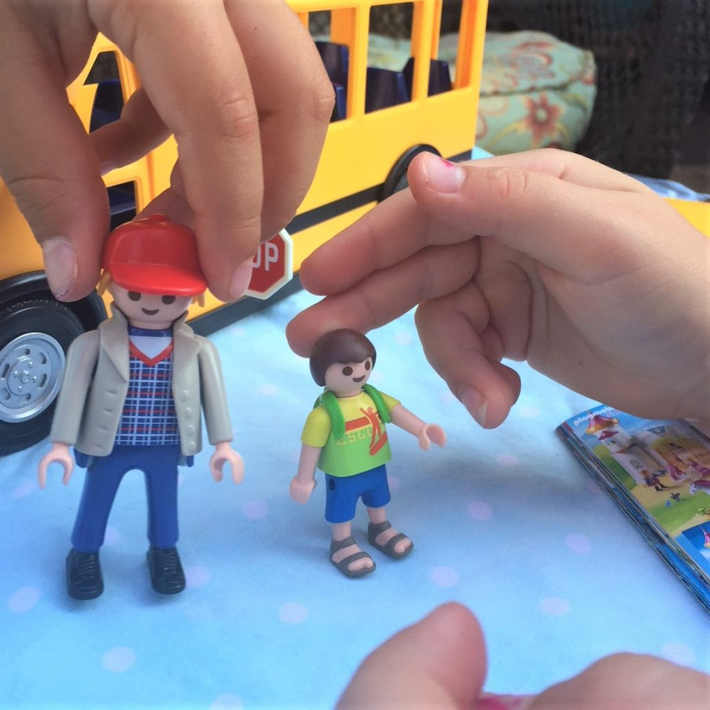 kids playing with playmobil