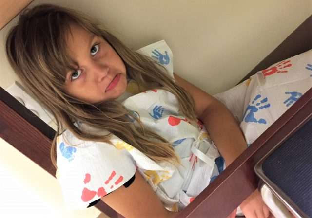 little girl sick at doctor