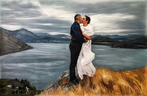 A couple embracing on their wedding day. The perfect paint to picture moment.